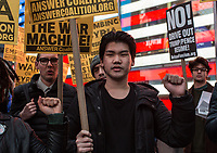 NEW YORK, NY - APRIL 07 : Demonstrators gather in Times Square at a rally to condemn the U.S. Bombing of Syria. The United States launched a military strike Thursday on a Syrian government airbase in response to a chemical weapons attack that killed dozens of civilians earlier in the week. In New York City on April 07, 2017. VIEWpress/Maite H. Mateo