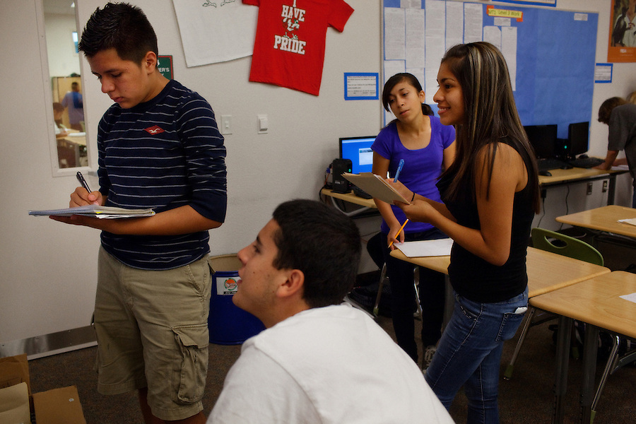 """Lindsay, California, September 5, 2012 - Students in Marisa Rodriguez's World History class break into groups to focus on the different stages of the French Revolution. Rodriguez says that the group participation engages the students more, forcing them to think more and dig deeper. Adding, """"It's important that they reach this on their own, in their own way. That is more meaningful to them.""""..Lindsay High School began building a competency-based education model about 7 years ago, fully implementing it just over three years ago and is set to graduate its first class this school year. This model does away with traditional grading and pass/fail for grades. Instead students are expected to achieve proficiency in a range of areas in each class, where a 3 (equal to a traditional B) is passing; A 4 is considered intensive and usually denotes college bound. Says Principal Jaime Robles, ?This allows students to learn at there own pace. If a student is advanced, they can move ahead, and if a student is lagging, they get the support they need.? Part of this model allows for students who are more advanced dig deeper and push harder and truly move ahead of others. Because they are ahead, some spend the extra time learning more, others take concurrent classes at the nearby community college and some choose to graduate early to start their path. ?Each student has their own set of goals,? says English teacher Amalia Lopez, ?Whatever their goals are, we support them.?.Slug: DD_ CompetencyByline: Daryl Peveto / LUCEO for Education Week"""