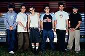 MIAMI FL - APRIL 27 : Mike Shinoda, Joe Hahn, Chester Bennington, Dave Farrell, Brad Delson and Rob Bourdon of Linkin Park pose for a portrait at Bayfront Park Ampitheatre on April 27, 2001 in Miami, Florida. : Credit Larry Marano (C) 2001