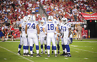 Sept. 27, 2009; Glendale, AZ, USA; Indianapolis Colts quarterback (18) Peyton Manning in the huddle with teammates against the Arizona Cardinals at University of Phoenix Stadium. Indianapolis defeated Arizona 31-10. Mandatory Credit: Mark J. Rebilas-