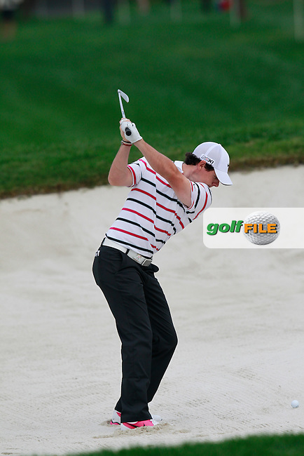 Rory McIlroy (NIR) plays his 2nd shot from a fairway bunker on the 8th hole during Thursday's Round 1 of the 2013 WGC-HSBC Champions held at the Sheshan International Golf Club, Shanghai, China. 31st October 2013.<br /> Picture: Eoin Clarke/www.golffile.ie