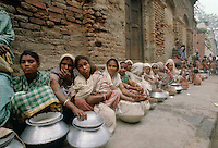 Poor people queue at Mother Teresa's Mission for the Poor in Calcutta, India