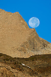 Full moon setting over mountains; near Tioga Pass; Eastern Sierra; California