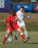 St. Lawrence forward Morgan Smith (15) attempts to control the ball as Amherst forward Christopher Martin (13) pressures. NCAA Division III Sectionals. In double-overtime, Amherst College (white) defeated St. Lawrence University (red), 2-1, on Hitchcock Field at Amherst College on November 23, 2013.