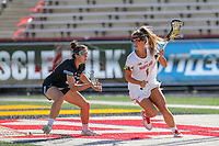 College Park, MD - April 27, 2019: Maryland Terrapins attack Brindi Griffin (1) runs with the ball during the game between John Hopkins and Maryland at  Capital One Field at Maryland Stadium in College Park, MD.  (Photo by Elliott Brown/Media Images International)