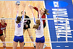 KANSAS CITY, MO - DECEMBER 16: Annika Albrecht (17) of the University of Nebraska spikes the ball past Rachael Kramer (5) and Cheyenne Huskey (11) of the University of Florida during the Division I Women's Volleyball Championship held at Sprint Center on December 16, 2017 in Kansas City, Missouri. (Photo by Jamie Schwaberow/NCAA Photos via Getty Images)