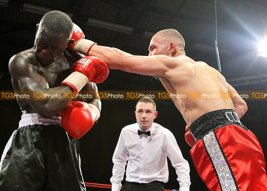 Erick Ochieng (black shorts) defeats Curtis Valentine in a Light-Middleweight boxing contest at Goresbrook Leisure Centre, Dagenham, promoted by Frank Maloney - 14/05/10 - MANDATORY CREDIT: Gavin Ellis/TGSPHOTO - Self billing applies where appropriate - Tel: 0845 094 6026