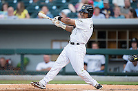 Micah Johnson (3) of the Charlotte Knights follows through on his swing against the Durham Bulls at BB&T BallPark on July 22, 2015 in Charlotte, North Carolina.  The Knights defeated the Bulls 6-4.  (Brian Westerholt/Four Seam Images)