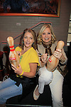 "Guiding Light Denise Pence ""Katie"" poses with Tina Sloan and bowling pins at 9th Annual Daytime Stars & Strikes Charity Event to benefit The American Cancer Society on October 7, 2012 at Bowlmor Lanes Times Square, New York City, New York.  (Photo by Sue Coflin/Max Photos)"