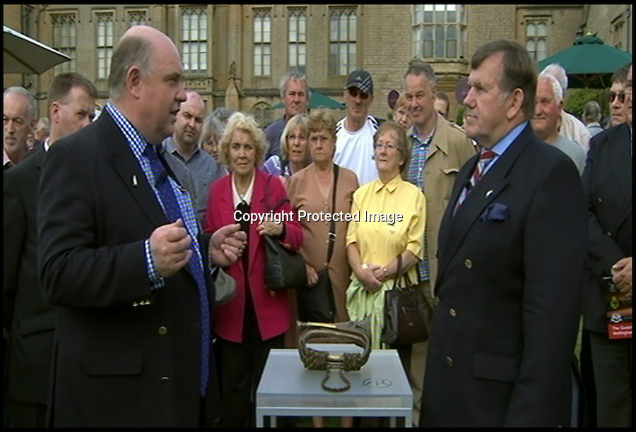 BNPS.co.uk (01202) 558833<br /> Picture: AntiquesRoadshow/BNPS<br /> <br /> Excited expert Bill Harryman talks to Capt Nick Holtby about the historic bugle.<br /> <br /> The bugle that sounded the catastrophic orders for the Charge of the Light Brigade has emerged on TV's Antiques Roadshow.<br /> <br /> The battered instrument was carried into the suicidal battle of the Crimea War in 1864 by William Britain, the Lord Cardigan's duty trumpeter.<br /> <br /> He took orders directly from the Earl, who led the cavalry, and blew on his bugle several times to signal the men to walk, canter and then charge at the Russian guns.