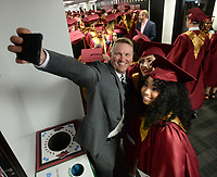 NWA Democrat-Gazette/ANDY SHUPE<br /> William Felts (from left), a teacher at Rogers New Technology High School, takes a selfie Wednesday, May 15, 2019, with students Samantha Miranda and Kiara Alarcon before the start of the school's commencement exercises in Barnhill Arena on the University of Arkansas campus in Fayetteville. The school graduated about 170 seniors during the ceremony.