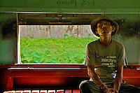 Man Inside the train carriage near Yangon Myanmar/Burma