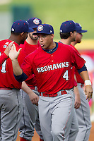Oklahoma City Redhawks outfielder George Springer #4 is introduced before the Pacific Coast League baseball game against the Round Rock Express on April 3, 2014 at the Dell Diamond in Round Rock, Texas. The Redhawks defeated the Express 7-6 in the season opener for both teams. (Andrew Woolley/Four Seam Images)