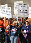 Lisa Contos cheers at a pro-labor rally held to protest a bill that would change the use of prevailing wages in Nevada, on Wednesday, March 27, 2013. Approximately 200 people attended the event in front of the Legislative Building in Carson City, Nev. (AP Photo/Cathleen Allison)