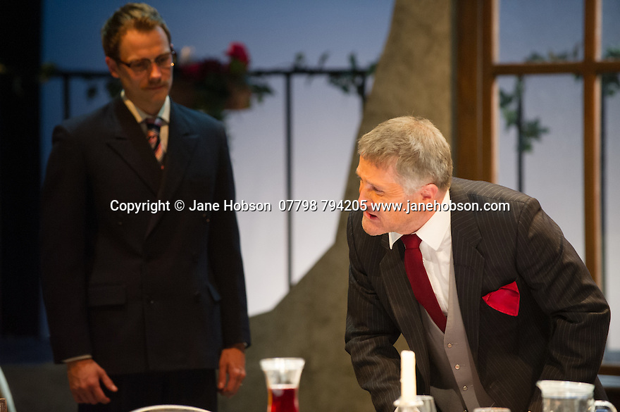 London, UK. 18.07.2014. Mountview Academy of Theatre Arts presents SATURDAY, SUNDAY, MONDAY by Eduardo de Filippo, the English adaptation by Keith Waterhouse & Willis Hall, directed by Michael Howcroft, at the Unicorn Theatre, as part of the Postgraduate Season 2014. Picture shows: Robert Ansell (Roberto) and Mark Desmond (Antonio).   Photograph © Jane Hobson.