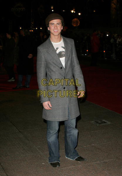 "RICHARD FLEESHMAN.Arrivals - ""Eragon"" World Premiere, .Odeon Leicester Square, London, .England, December 11th 2006..full length grey coat cap hat jeans.CAP/AH.©Adam Houghton/Capital Pictures"