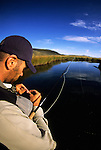 A young man fishes on Flat Creek in Jackson Hole, Wyoming.