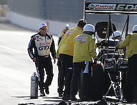 Feb. 15, 2013; Pomona, CA, USA; NHRA funny car driver John Force (left) tends to daughter, top fuel dragster driver Brittany Force during qualifying for the Winternationals at Auto Club Raceway at Pomona. Mandatory Credit: Mark J. Rebilas-