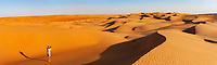Panorama, man photographing in the desert, sand dunes, Sharqiya Sands, Oman