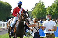 Winner of The AJN Steelstock Sovereign Stakes  Regal Reality ridden by Richard Kingscote (blue cap) and trained by Sir Michael Stoute in the Winners enclosure during Horse Racing at Salisbury Racecourse on 9th August 2020