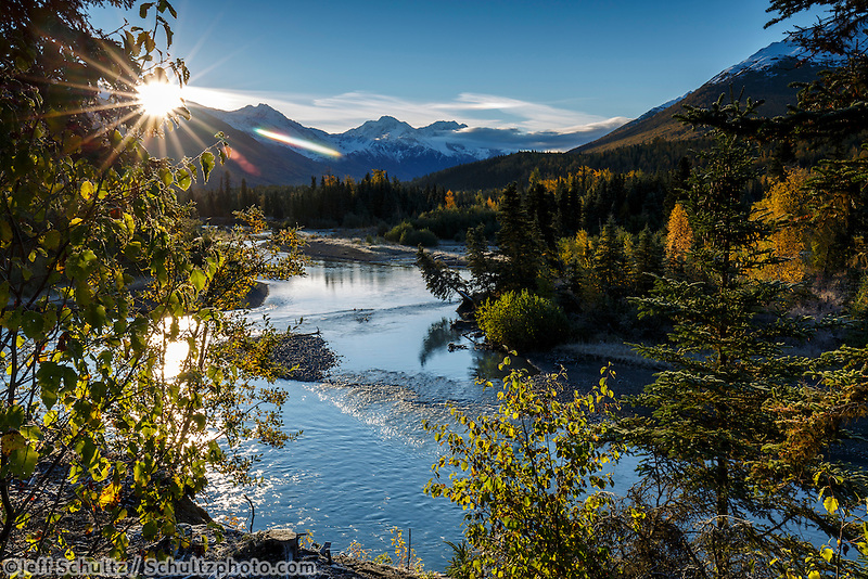 Fall landscape of early snow on Chugach Mountains in the Eagle River valley at sunrise with Eagle River in foreground.  Alaska  September 2015