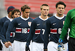 Heath Pearce (6), Chris Rolfe (7), and Josh Wolff (16), of the United States, march onto the field before the game on Sunday, February 19th, 2005 at Pizza Hut Park in Frisco, Texas. The United States Men's National Team defeated Guatemala 4-0 in a men's international friendly.