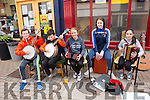 Busking on the streets of Cahersiveen for the Mountain Roots Music weekend on Saturday were l-r; Mikie Kavanagh, Kieran O'Donnell, Ruth O'Shea, Ellie O'Connell & Shannon O'Donnell.