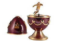 BNPS.co.uk (01202 558833)<br /> Pic: Dukes/BNPS<br /> <br /> On Me Egg, Son...<br /> <br /> A rare Faberge egg made to commemorate George Best's leading role in Manchester United's first ever European Cup win has emerged for sale for £18,000.<br /> <br /> The 24-carat gold egg has a detachable top which can be removed to reveal a small statue of the legendary footballer.<br /> <br /> He has a diamond studded football at his feet and looks poised to set off on a trademark dribble.