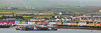 County Kerry, Ireland:<br /> Morning fog blankets the colorful port village of Portmagee, on the tip of the Iveragh peninsula