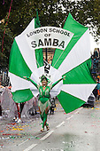 London, England. 31 August 2015. Performers from the London School of Samba on parade. Performers and revellers were in good spirits despite a second years of heavy rain on the Adult Day of Notting Hill Carnival. Photo: Bettina Strenske