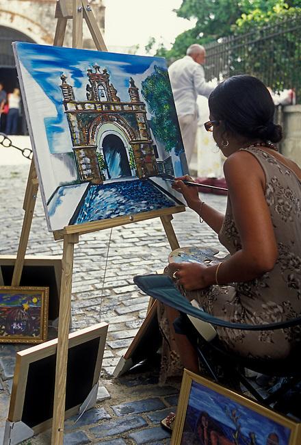 Painter along Calle del Cristo, Old San Juan, San Juan, Puerto Rico, West Indies