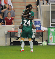 # 9 Eniola Aluko  of St. Louis Athletica  celebrates with teammate #24 Kendall Fletcher after scoring her second goal of the game. Athletica beat the Red Stars 2-0...