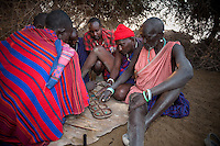 Men having not much to do in a typical Masai hierarchy and have to come up with many ingenious ways of passing time. The marble  game known as  bao, or mancala,  is a favorite activitiy.
