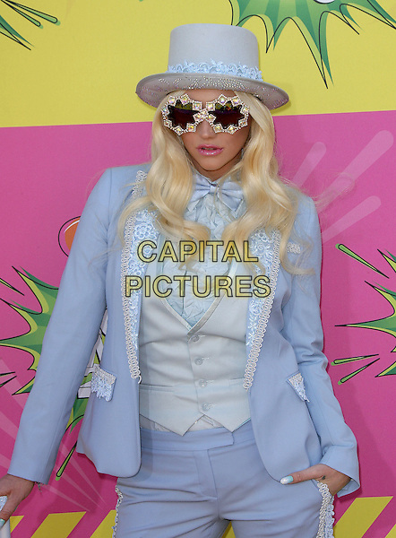 Ke$ha (Kesha Rose Sebert).at The Nickelodeon's Kids' Choice Awards 2013 held at The Galen Center in Los Angeles, California, USA,.March 23rd 2013.half length waistcoat trousers hand in pocket suit top hat blue sunglasses elton john style costume bow tie shirt lace seventies 70s jacket pastel baby .CAP/ADM.©AdMedia/Capital Pictures.