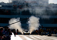 Oct 11, 2019; Concord, NC, USA; NHRA funny car driver J.R. Todd does a burnout during qualifying for the Carolina Nationals at zMax Dragway. Mandatory Credit: Mark J. Rebilas-USA TODAY Sports