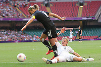 Ellen WHITE of Great Britain tackles Rebecca SMITH of New Zealand - Great Britain Women vs New Zealand Women - Womens Olympic Football Tournament London 2012 Group E at the Millenium Stadium, Cardiff, Wales - 25/07/12 - MANDATORY CREDIT: Gavin Ellis/SHEKICKS/TGSPHOTO - Self billing applies where appropriate - 0845 094 6026 - contact@tgsphoto.co.uk - NO UNPAID USE.