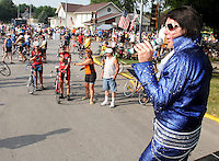 An Elvis Presley impersonator entertains a throng of riders entering Eagle Grove.