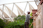 5 August 2010, NEW DELHI, INDIA: Construction continues on the main stadium precinct of Commonwealth Games venues in New Delhi,India as the Opening Ceremony approaches with organisers still claiming the sites will be completed on time. Serious doubts remain with much work still to be completed being hampered by monsoon rains. pic Graham Crouch