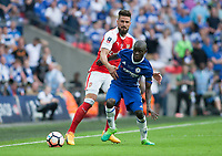 Ngolo Kante of Chelsea holds of Olivier Giroud of Arsenal during the FA Cup Final match between Arsenal v Chelsea, Wembley stadium, London on 27th May 2017