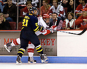 Francois Ouimet (Merrimack - 21), Ross Gaudet (BU - 22) - The Boston University Terriers defeated the Merrimack College Warriors 6-4 on Saturday, November 14, 2009, at Agganis Arena in Boston, Massachusetts.
