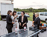 Raleigh, North Carolina- August 11, 2017<br /> <br /> (left to right) Ashley Arnwine, Katie Crutchfield, Allison Crutchfield and Katherine Simonetti of Waxahatchee share a beer before the band took the stage at the NCMA. <br /> <br /> Ex Hex and Waxahatchee played an outdoor concert with MERGE Records label mates Superchunk at the North Carolina Museum of Art. (Photo by Jeremy M. Lange for The New York Times)