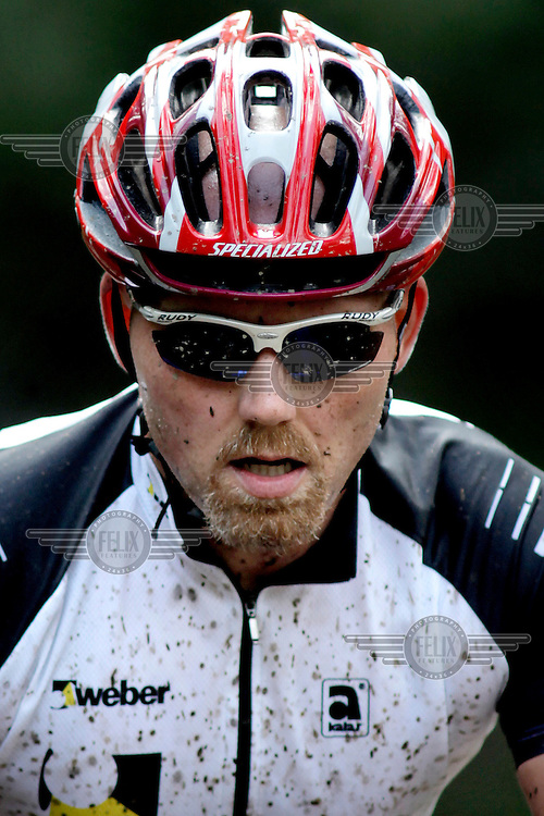 Muddy and tired rider. Kongerittet is a mountain bike race in the forest north of the Norwegian capital Oslo. There are two courses, 64km and 84km. The interest for these kind of bike races has exploded in Norway the last few years, particularly with middle age affluent men.
