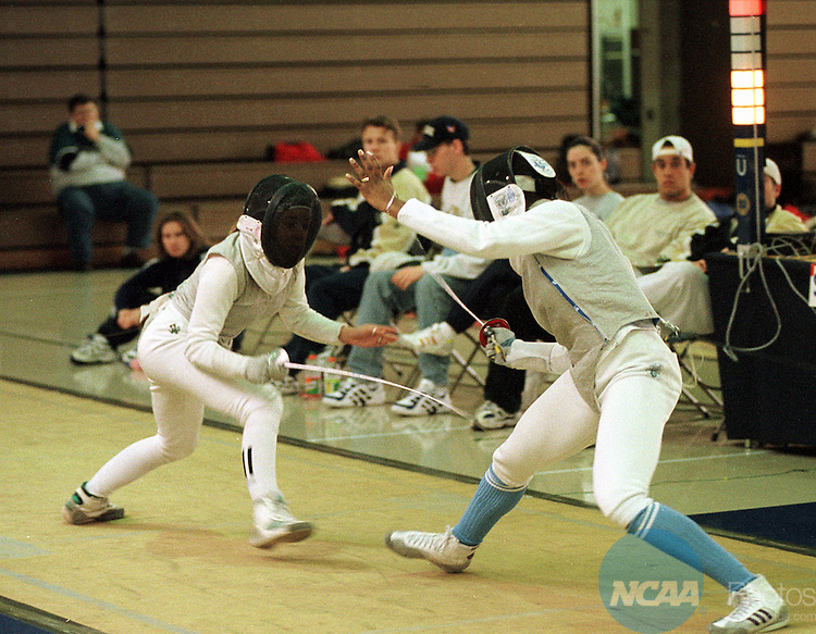 Caption: 22 MAR 1998: Charlotte Walker (left) of Penn State lunges toward her opponent Jessica Lisagor (right) of Stanford during the Women's Epee competition of the Men's and Women's Fencing Championship held at the Angela Athletic Facility - St. Mary's College in South Bend, IN. Walker took first place honors in the Epee. Joe Raymond/NCAA Photos