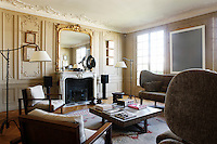 Traditional and contemporary elegantly co-exist in this panelled living room