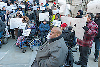 Wheelchair advocates joined by taxi and livery drivers rally on the steps of New York City Hall on Tuesday, January 19, 2016 against the City Council's Uber legislative package as it fails to address the lack of accessibility and its surge pricing. Uber has over 30,000 vehicles on the road in New York and not one of them is wheelchair accessible. (© Richard B. Levine)