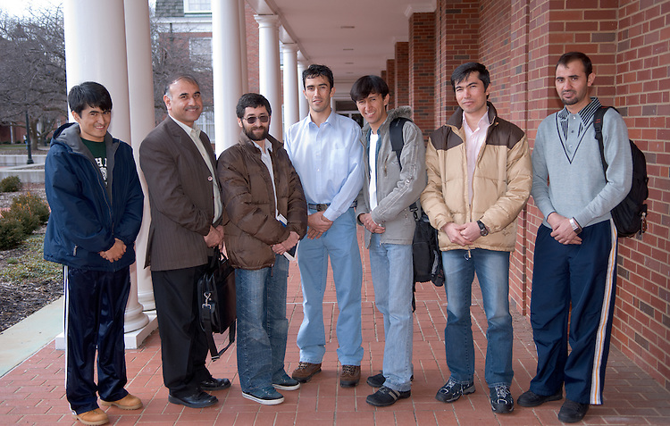 "Abd Qaium Fekrat, Mohammad Shafi Sharifi, Shah M Mehryoon, Farid A. Momand, Mohammad R Moallem, Aziz Ahmad Gulistani, and Asadullah Attal...Scholars dream of rebuilding Afghanistan..Seven pursue master's degrees in engineering ...Farid Momand isn't your typical civil engineering master's degree candidate. He, along with six others studying at Ohio University's Russ College of Engineering and Technology, is already a faculty member in his native country. ..Momand is part of Afghan Merit Scholar Program, in which faculty members from Kabul University and Kabul Polytechnic University are gaining knowledge to take home to help rebuild their war-torn country. ..Russ Professor of Civil Engineering Shad Sargand, originally from Afghanistan as well, started the program in hopes of helping his homeland. This year, the Afghan eQuality Alliance, an organization working with the United States Agency for International Development to improve the quality of higher education in Afghanistan, has enabled 18 of the 56 engineering faculty members at the two universities to enroll in higher education in either the United States or Japan. Six of Ohio University's students are from Kabul University and a seventh from Kabul Polytechnic...Momand said he knew he wanted to apply to Ohio University back in 2005. ?Dr. Sargand came and gave a presentation about his background in transportation research and introduced the program,? he said. ..The students, who range in age from 24 to the mid-40s, are enrolled in two-year master's degree programs in civil, mechanical or electrical engineering. One major program goal is to establish a research institute at the University of Kabul that the school's six Afghan Merit Scholars would run. ..?Afghanistan does a good job teaching theory, but there is no lab work,? Momand explained. ?But at Ohio University, a big part of our studies involves labs."" ..The institute, according to Sargand, would help the scholars continue to improve their technical backgrou"