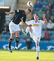 Dundee's Iain Davidson heads clear from Morton's Tony Wallace.