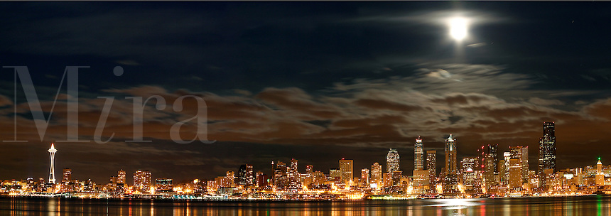 Seattle skyline, Space Needle and full moon reflecting in Elliot Bay viewed from West Seattle, Seattle, Washington, US
