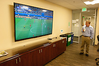 San Francisco, CA - Tuesday, July 1, 2014: Employees at Arthur J. Gallagher insurance company watch the USA vs. Belgium World Cup Round of 16 game in San Francisco.