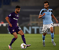 Football, Serie A: S.S. Lazio - Fiorentina, Olympic stadium, Rome, June 27, 2020. <br /> Fiorentina's Milan Badelj in action with Lazio's captain Marco Parolo (r) during the Italian Serie A football match between S.S. Lazio and Fiorentina at Rome's Olympic stadium, Rome, on June 27, 2020. <br /> UPDATE IMAGES PRESS/Isabella Bonotto
